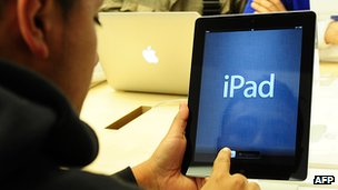 A consumer using iPad