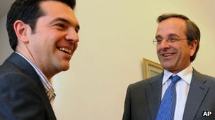 New Democracy leader Antonis Samaras, (right), speaks with Syriza leader Alexis Tsipras