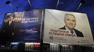 Campaign posters for Boris Tadic(L) and Tomislav Nikolic (R)
