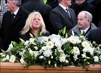 The politician's wife was joined by hundreds of mourners