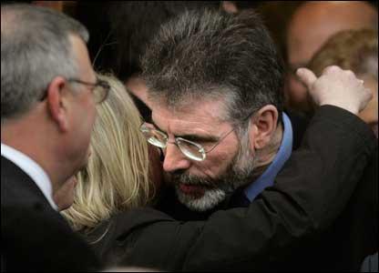 Gerry Adams comforted Mr Ervine's widow Jeanette