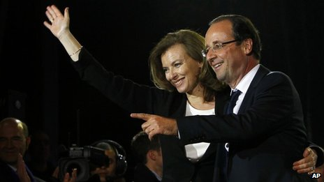 French president-elect Francois Hollande and Valerie Trierweiler greeting crowds gathered to celebrate his election victory in Bastille Square in Paris, France, 6 May 2012.