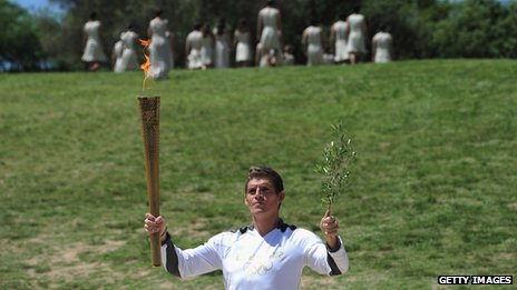 World champion swimmer Spyros Gianniotis with the torch at the rehearsal