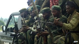 Congolese army soldiers sit in a truck near on 5 May in the Masisi territory of North Kivu province