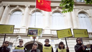 Amnesty International activists take part in a protest in support of Chen Guangcheng, on 9 May, 2012 in front of China's embassy in Paris