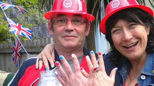 A man and woman show their painted nails at a street party in Cardiff