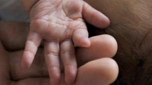Newborn baby and hands