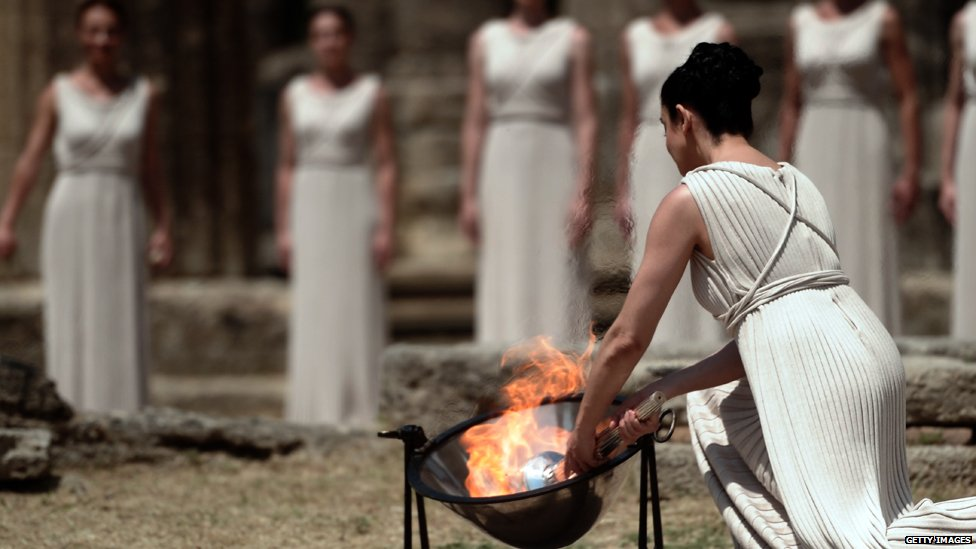 flame lighting olympics. high priestess ino menegaki lights the olympic flame at temple of hera during lighting olympics y