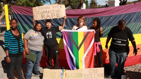 Protesters holding up a sign saying 'down with corrective rape'