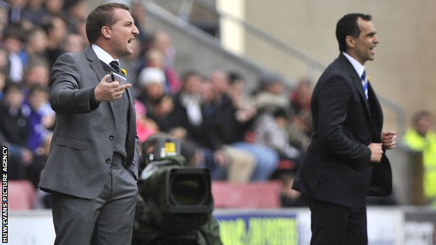 Swansea City manager Brendan Rodgers alongside Wigan Athletic manager Roberto Martinez