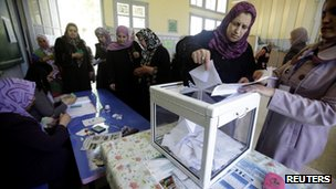 A woman casts her ballot during parliamentary elections at a polling station in the Berber region of Issers, east of Algiers, May 10, 2012