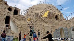 Iraqis inspect the bombed holy shrine of al-Askari  in the Iraqi northern city of Samarra, 22 February 2006