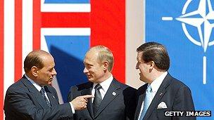 Italian Premier Berlusconi, Russian President Putin and Nato Secretary-General Robertson
