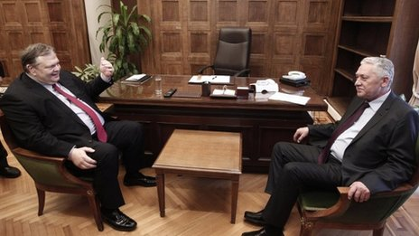 Greek Socialist leader Evangelos Venizelos. left. talks with Democratic Left leader Fotis Kouvelis at his office at the Greek Parliament in Athens on Thursday May 10, 2012