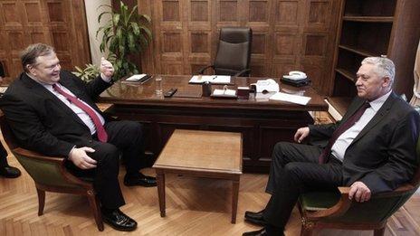 Greek Socialist leader Evangelos Venizelos. left. talks with Democratic Left leader Fotis Kouvelis at his office at the Greek Parliament in Athens on Thursday May 10, 2012