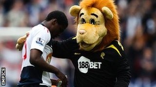 Bolton's Dedryck Boyata with mascot Lofty the Lion