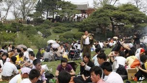 North Koreans picnic in front of Ulmil Pavilion on Moran Hill, in Pyongyang, North Korea, on 1 May, 2012