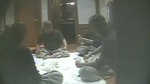 Video footage shows some monks gambling