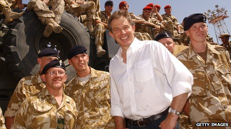 Tony Blair with troops in the port of Umm Qasr, Iraq, in May 2003