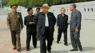 Mr Kim appeared relaxed amongst officials (Source: North Korean TV)