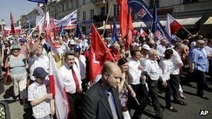 Members of Poland&#039;s Democratic Left Alliance party protests in Warsaw on 1 May 2012 against government plans to raise the retirement age to 67