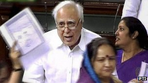 MPs wave copies of the cartoon as Education Minister Kapil Sibal speaks in parliament on 11 May 2012