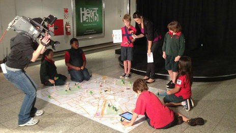 Newmarket students with their traffic planning map - and a NZTV camera crew!
