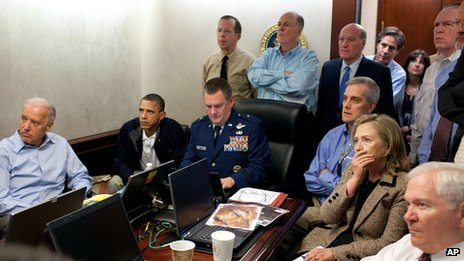 President Barack Obama, second from left, Vice President Joe Biden, left, Secretary of Defense Robert Gates, right, Secretary of State Hillary Rodham Clinton, second right, and members of the national security team watch an update on the mission against Osama Bin Laden in the Situation Room of the White House in Washington on 1 May 2011.