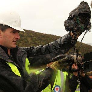 Dan Snow looks at preserved helmet