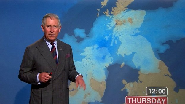 Prince Charles presenting in front of a weather map.