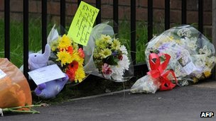 Flowers and tributes left near the house