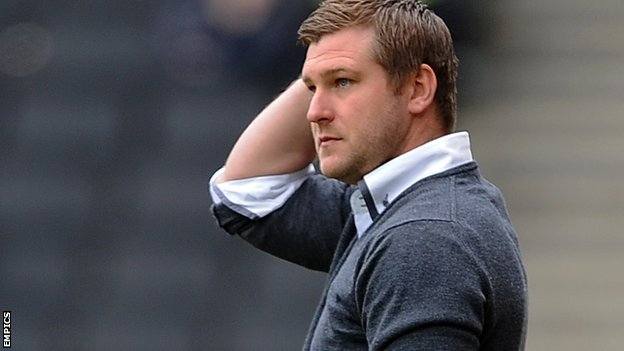 MK Dons boss Karl Robinson