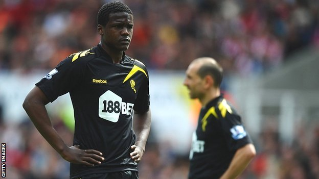 Dedryck Boyata (left) and Martin Petrov of Bolton Wanderers look dejected