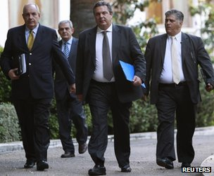 Independent Greeks party leader Panos Kammenos (2nd R) leaves the presidential mansion in Athens, 13 May