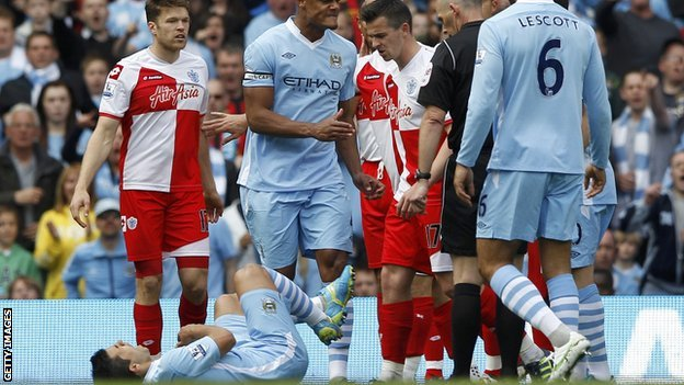 QPR captain Joey Barton kicks out at Manchester City striker Sergio Aguero