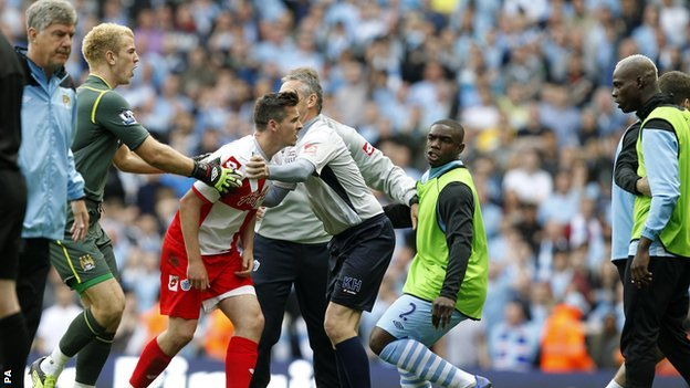 QPR captain Joey Barton is confronted after being sent off