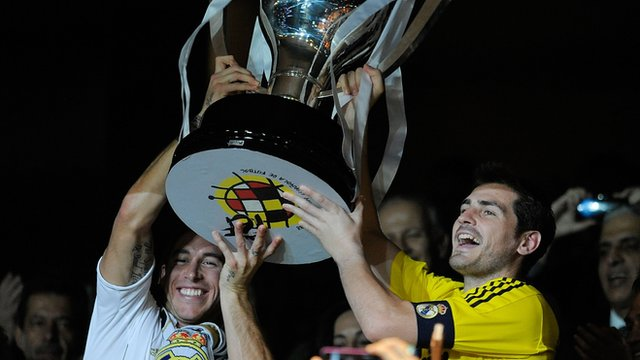 Real Madrid's Sergio Ramos and Iker Casillas lift La Liga