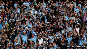 Manchester City fans celebrate their team's Premier League win in 2012