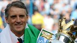 Manchester City manager Roberto Mancini with the Premier League trophy