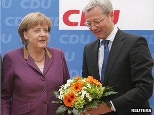 Chancellor Angela Merkel and Environment Minister Norbert Roettgen after election defeat in North Rhine-Westphalia