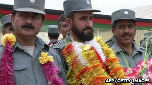 Afghan National Police personnel wear garlands during their graduation ceremony in Jalalabad, April 2012