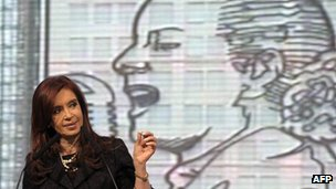Argentine President Fernandez in front of a mural of Evita