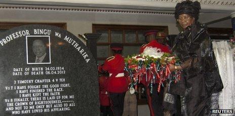 Malawi's President Joyce Banda lays a wreath during a funeral service for late president Bingu wa Mutharika