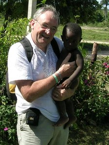 Man holding a young child: Photo: David Wood