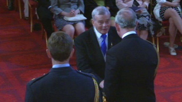Dickie Bird receives his OBE from Prince Charles (Credit: BCA)
