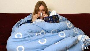 Sick woman under a duvet.