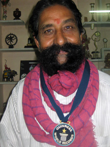 Ram Singh Chauhan with his medal for longest moustache