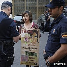 Woman protesting against evictions in Madrid, 14 May 12