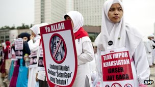 Muslim Activists take part in protest against US pop diva Lady Gaga upcoming concert in Jakarta on April 29, 2012. 