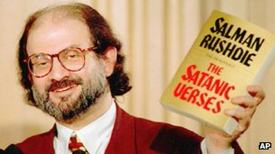 Salman Rushdie holds up a copy of the Satanic Verses in 1992